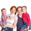 Happy family smiling at the camera — Stock Photo #10628278