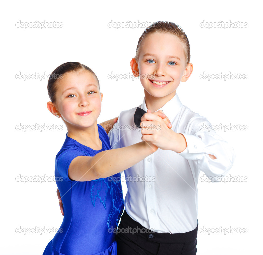 Clouseup portrait of young ballroom dancers in formal costumes posing. Isolated on white background  Stock Photo #10629376
