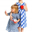 Two young beautiful girls with cup — Stock Photo