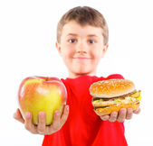 Boy eating a hamburger. — Stock Photo