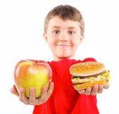 Boy eating a hamburger. — Stock Photo