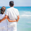 Romantic young couple together on the beach — Stock Photo #10712565