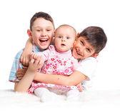 Close-up van gelukkige kinderen in studio — Stockfoto