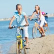 Cute girl with her mother and brother ride bikes — Stock Photo #10725142