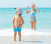 Happy children on beach — Stock Photo