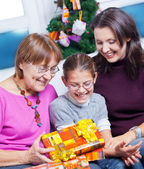 Girl and her mother and grandmother with gifts — Stockfoto