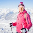 Young womwith skis and ski wear — Stock Photo #8823254