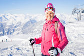 Young woman with skis and a ski wear — Stock Photo