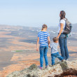Mother and her child standing on cliff's edge — Stock Photo #8830244