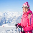 Young womwith skis and ski wear — Stock Photo #8887873