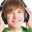 Portrait of a male teenager listening to music — Stock Photo