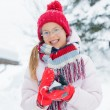 Happy girl having fun on snowing winter day. — Stock Photo