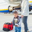 Cute boy and his grandmother prepared to fly — Stock Photo #8929952