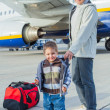 Cute boy and his grandmother prepared to fly — Stock Photo