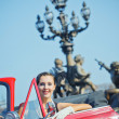 Happy smiling woman in a car. Romantic in Paris. — Stock Photo