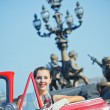Happy smiling woman in a car. Romantic in Paris. — Stock Photo #8931658