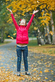 Cute girl walking in the autumn park — Stock Photo