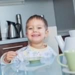 Happy Boy Eating Breakfast — Stock Photo
