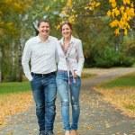 Romantic young beautiful couple on autumn walk — Stock Photo