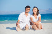 Happy young couple on the beach — Stock Photo
