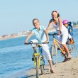 Cute girl with her mother and brother ride bikes — Stock Photo #9021035