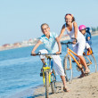 Stock Photo: Cute girl with her mother and brother ride bikes