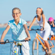 Royalty-Free Stock Photo: Cute girl with her mother and brother ride bikes
