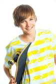 Portrait blond boy with skateboard — Stock Photo