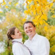 Romantic young beautiful couple on autumn walk — Stock Photo #9039232