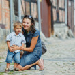 Mother and her little son in city — Stock Photo #9057634
