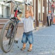 Cute little boy with big bike — Stock Photo