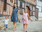 Mother and her child in city — Stock Photo