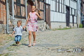 Cute brother and sister in city — Stock Photo