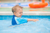 Boy playing in a pool of water — Stock Photo
