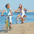 Cute girl with her mother and brother ride bikes — Stock Photo #9102628