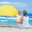 Boy and his mother with big umbrella — Stock Photo #9104668