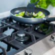 Gas-stove with vegetables dish prepared — Stock Photo