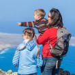Mother and her child standing on cliff's edge — Stock Photo