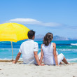 Couple sitting together on the beach — Stock Photo