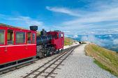 Cog railway train climbing up to the mountain — Stock Photo