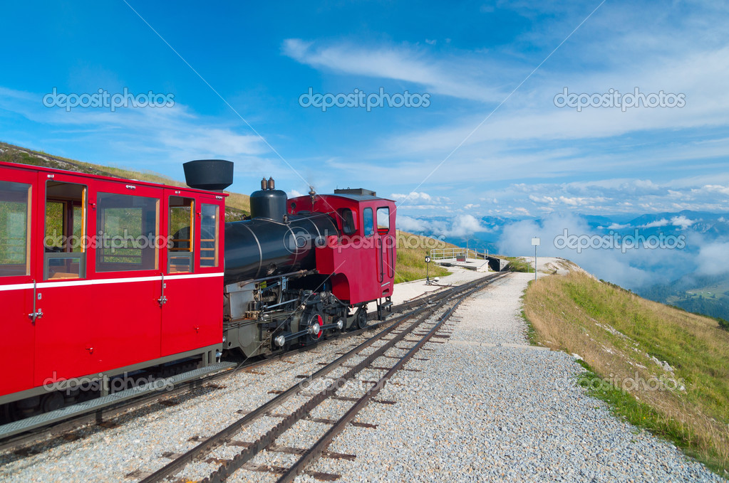 Austrian alpine cog railway train climbing up to the mountain — Stock Photo #9117573