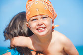 Cute little boy and his mother at beach — Stock Photo