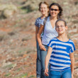 Family hiking in the cross-country — Stock Photo