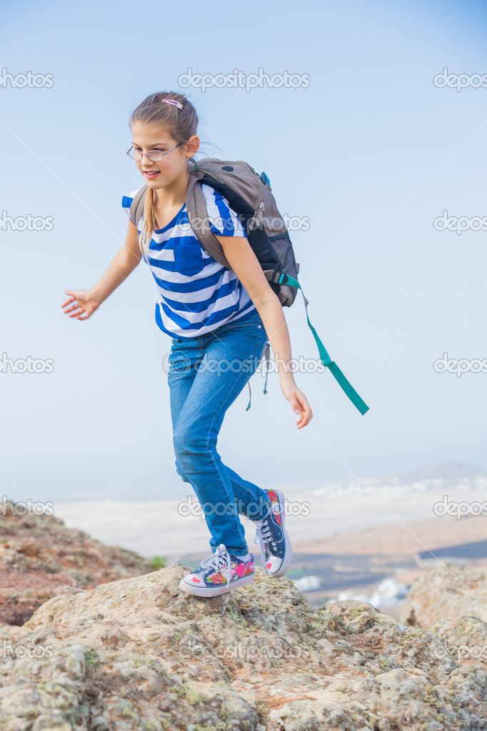 Cute young girl with backpack have trip in the mountains  Stock Photo #9149739