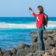 Young woman photographing a beautiful view — Stock Photo