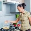 Portrait of a girl cooking — Stock Photo