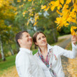 Romantic young beautiful couple on autumn walk — Stock Photo
