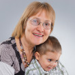 Portrait of senior woman with her grandson — Stock Photo