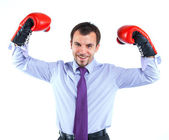 Portrait of a business man in red boxing gloves — Stock Photo