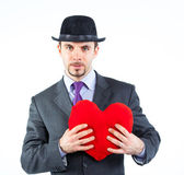 Portrait of a business man with hat and red heart — Stock Photo